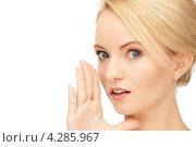 Купить «Довольная девушка охотно сплетничает на белом фоне», фото № 4285967, снято 12 февраля 2011 г. (c) Syda Productions / Фотобанк Лори