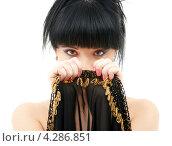 Купить «Притягательная брюнетка с челкой прикрывает лицо платком», фото № 4286851, снято 12 апреля 2008 г. (c) Syda Productions / Фотобанк Лори