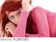 Купить «Загадочная девушка в розовом свитере на белом фоне», фото № 4289583, снято 16 марта 2008 г. (c) Syda Productions / Фотобанк Лори