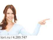 Купить «Привлекательная деловая девушка указывает на что-то пальцем», фото № 4289747, снято 11 сентября 2010 г. (c) Syda Productions / Фотобанк Лори