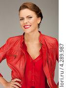 Купить «Яркая молодая шатенка в красной кожаной куртке», фото № 4289987, снято 12 марта 2011 г. (c) Syda Productions / Фотобанк Лори