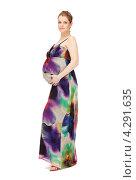 Купить «Молодая беременная женщина с длинными русыми волосами в сарафане на белом фоне», фото № 4291635, снято 12 марта 2011 г. (c) Syda Productions / Фотобанк Лори