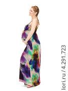 Купить «Молодая беременная женщина с длинными русыми волосами в сарафане на белом фоне», фото № 4291723, снято 12 марта 2011 г. (c) Syda Productions / Фотобанк Лори