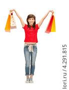 Купить «Счастливая покупательница в красной блузке с пакетами в руках», фото № 4291815, снято 20 марта 2011 г. (c) Syda Productions / Фотобанк Лори
