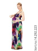 Купить «Молодая беременная женщина с длинными русыми волосами в сарафане на белом фоне», фото № 4292223, снято 12 марта 2011 г. (c) Syda Productions / Фотобанк Лори