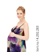 Купить «Молодая беременная женщина с длинными русыми волосами в сарафане на белом фоне», фото № 4292283, снято 12 марта 2011 г. (c) Syda Productions / Фотобанк Лори