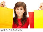 Купить «Счастливая покупательница в красной блузке с пакетами в руках», фото № 4292615, снято 20 марта 2011 г. (c) Syda Productions / Фотобанк Лори