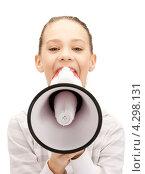 Счастливая девочка с мегафоном на белом фоне. Стоковое фото, фотограф Syda Productions / Фотобанк Лори