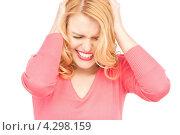 Купить «Несчастная растрепанная блондинка на белом фоне», фото № 4298159, снято 28 марта 2010 г. (c) Syda Productions / Фотобанк Лори