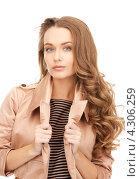 Купить «Очаровательная женщина с длинными густыми волосами в бежевом пальто», фото № 4306259, снято 10 октября 2010 г. (c) Syda Productions / Фотобанк Лори