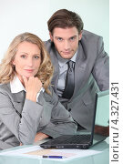 Купить «Коллеги в серых костюмах за рабочим столом», фото № 4327431, снято 20 мая 2010 г. (c) Phovoir Images / Фотобанк Лори