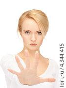 Купить «Недовольная молодая женщина выставила руку вперед в жесте стоп», фото № 4344415, снято 12 февраля 2011 г. (c) Syda Productions / Фотобанк Лори