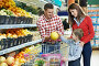 Купить «Семья выбирает продукты в супермаркете», фото № 4347539, снято 2 октября 2012 г. (c) Дмитрий Калиновский / Фотобанк Лори