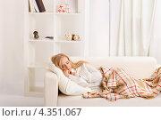 Купить «Девушка спит на диване под пледом», фото № 4351067, снято 19 июля 2018 г. (c) Коваль Василий / Фотобанк Лори