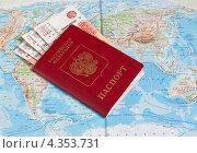 Купить «Российский заграничный паспорт с деньгами лежит на карте мира», эксклюзивное фото № 4353731, снято 28 февраля 2013 г. (c) Игорь Низов / Фотобанк Лори