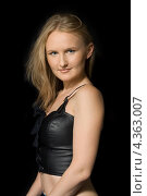 Купить «Молодая женщина со светлыми волосами в черном бюстье на черном фоне», фото № 4363007, снято 21 мая 2006 г. (c) Syda Productions / Фотобанк Лори