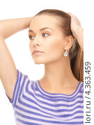 Купить «Симпатичная молодая женщина в тельняшке на белом фоне», фото № 4363459, снято 10 октября 2010 г. (c) Syda Productions / Фотобанк Лори