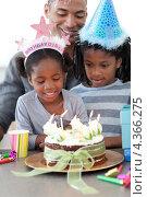 Купить «Темнокожие дети и их отец празднуют день рождения», фото № 4366275, снято 21 октября 2009 г. (c) Wavebreak Media / Фотобанк Лори
