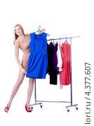 Купить «Модница выбрала синее платье с вешалки», фото № 4377607, снято 11 декабря 2012 г. (c) Elnur / Фотобанк Лори