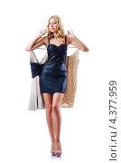 Купить «Стройная женщина в черном коротком платье держит новую одежду на вешалках, белый фон», фото № 4377959, снято 12 сентября 2012 г. (c) Elnur / Фотобанк Лори
