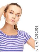 Купить «Стройная молодая женщина в бело-синей тельняшке с длинными рукавами», фото № 4380859, снято 10 октября 2010 г. (c) Syda Productions / Фотобанк Лори