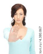 Купить «Расстроенная девушка показывает рукой жест стоп», фото № 4380867, снято 16 октября 2011 г. (c) Syda Productions / Фотобанк Лори