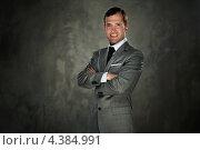 Мужчина в строгом сером костюме, фото № 4384991, снято 14 мая 2012 г. (c) Andrejs Pidjass / Фотобанк Лори