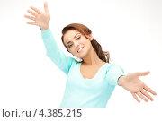 Купить «Счастливая молодая женщина размахивает руками на белом фоне», фото № 4385215, снято 22 ноября 2011 г. (c) Syda Productions / Фотобанк Лори
