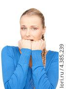 Купить «Девушка держит кулачки, переживая за что-то», фото № 4385239, снято 8 мая 2010 г. (c) Syda Productions / Фотобанк Лори