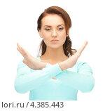 Купить «Девушка с напряженным лицом показывает руками жест стоп», фото № 4385443, снято 22 ноября 2011 г. (c) Syda Productions / Фотобанк Лори