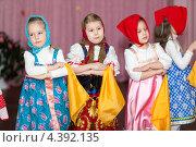 Купить «Девочки с платочками в руках и платками на голове танцуют русские народные танцы», фото № 4392135, снято 5 марта 2013 г. (c) Кекяляйнен Андрей / Фотобанк Лори