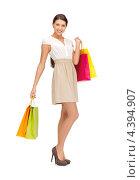 Купить «Красивая стройная девушка с покупками на белом фоне», фото № 4394907, снято 31 марта 2012 г. (c) Syda Productions / Фотобанк Лори