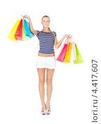 Купить «Счастливая молодая покупательница на белом фоне с пакетами», фото № 4417607, снято 8 мая 2010 г. (c) Syda Productions / Фотобанк Лори