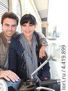 Купить «Влюбленная пара с скутером», фото № 4419899, снято 15 апреля 2010 г. (c) Phovoir Images / Фотобанк Лори