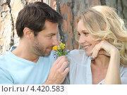 Купить «Счастливые муж и жена у дерева», фото № 4420583, снято 18 мая 2010 г. (c) Phovoir Images / Фотобанк Лори