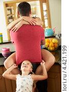 Купить «Отец, обнимающий на кухне маму, и дочка рядом», фото № 4421199, снято 17 июля 2012 г. (c) Monkey Business Images / Фотобанк Лори