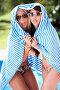 Девушки, закутавшись в полотенце, показывают язык, фото № 4421371, снято 10 июля 2012 г. (c) Monkey Business Images / Фотобанк Лори