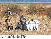 Купить «Историческая реконструкция, люди в одежде средневековых воинов прячутся за щитами», фото № 4429879, снято 22 апреля 2012 г. (c) Raulin / Фотобанк Лори