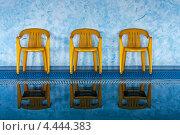 Купить «Три желтых стула у бассейна», фото № 4444383, снято 19 августа 2012 г. (c) Иван Бондаренко / Фотобанк Лори