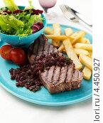Купить «Тарелка с говяжьим стейком и картофелем фри», фото № 4450927, снято 25 мая 2019 г. (c) Food And Drink Photos / Фотобанк Лори