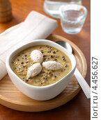 Купить «Суп-пюре из чечевицы на обеденном столе», фото № 4456627, снято 23 мая 2019 г. (c) Food And Drink Photos / Фотобанк Лори