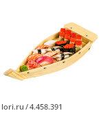 Купить «Суши ассорти в деревянной тарелке в виде лодки на белом фоне», фото № 4458391, снято 5 ноября 2012 г. (c) Андрей Армягов / Фотобанк Лори