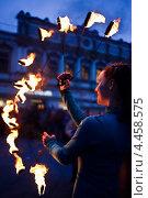 Купить «Выступление с огнем», фото № 4458575, снято 17 марта 2013 г. (c) Victoria Demidova / Фотобанк Лори