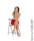 Купить «Красивая кокетливая девушка в красной юбке сидит на стуле», фото № 4465987, снято 12 апреля 2012 г. (c) Syda Productions / Фотобанк Лори