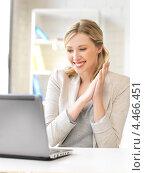 Купить «Счастливая молодая женщина работает за ноутбуком в офисе», фото № 4466451, снято 17 июня 2012 г. (c) Syda Productions / Фотобанк Лори