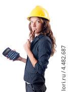Купить «Женщина в строительной каске с калькулятором», фото № 4482687, снято 24 июля 2012 г. (c) Elnur / Фотобанк Лори