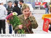 Купить «Девушка в форме образца Великой Отечественной войны», эксклюзивное фото № 4512891, снято 9 мая 2012 г. (c) Алёшина Оксана / Фотобанк Лори