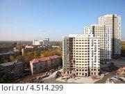 """Купить «Строительство жилого комплекса недалеко от парка """"Лосиный остров"""" в Москве», фото № 4514299, снято 7 октября 2011 г. (c) Losevsky Pavel / Фотобанк Лори"""