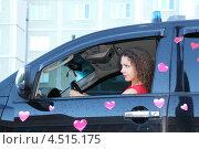 Купить «Молодая женщина в  сидит за рулем черного автомобиля», фото № 4515175, снято 3 сентября 2011 г. (c) Losevsky Pavel / Фотобанк Лори