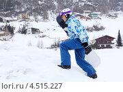 Купить «Сноубордист в горнолыжном костюме взбирается на гору», фото № 4515227, снято 14 февраля 2012 г. (c) Losevsky Pavel / Фотобанк Лори